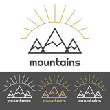 Mountains camp logo with sunrise behind the hills Royalty Free Stock Image
