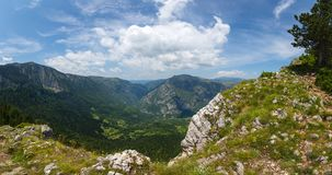 Mountains and canyon in Durmitor, Montenegro. Panorama view from the heights to the mountains and picturesque canyon in Durmitor National Park, Montenegro Stock Image