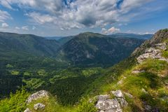 Mountains and canyon in Durmitor, Montenegro. View from the heights to the mountains and picturesque canyon in Durmitor National Park, Montenegro Royalty Free Stock Photo