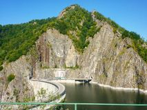 Mountains. Carpathian mountains, dam,  and river in Romania Royalty Free Stock Photography