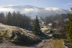 Mountains of carpathians top snow mist royalty free stock image