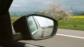 Mountains and cars and highway seen in the rear-view mirror of a car  in Germany stock footage