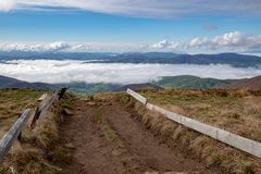 Mountains in Central Europe in the morning. The valley covered with a layer of clouds royalty free stock photography