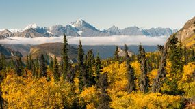 Chugach Mountains Matanuska River Valley Alaska United States. Mountains in the Chugach Range stand above the clouds rising from the Valley in Alaska North stock images