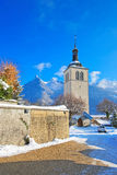Mountains and church near Gruyere castle in winter Stock Photo