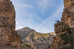 Mountains through the cliffs at Guadalupe Mountains. Guadalupe Mountains viewed through the cliffs on the Devil`s Hall trail Stock Photo