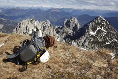 Mountains and climber backpack with helmet Royalty Free Stock Image