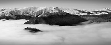 Mountains in the clouds Stock Images