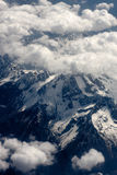 Mountains through the clouds Royalty Free Stock Image