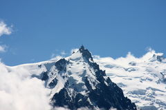Mountains in the clouds. Clouds and snowfields on a peak of the Mont Blanc range Royalty Free Stock Image