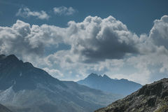 Mountains With Clouds Above during Day Time Royalty Free Stock Photos