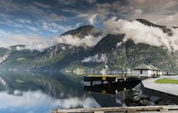 Mountains and clouds above the eidfjord in norway Royalty Free Stock Image