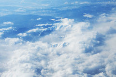 Mountains and clouds from airplane Royalty Free Stock Image