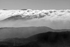 Mountains and clouds in black and white Stock Image