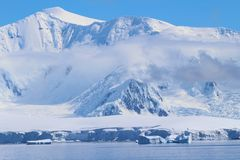 Mountains, clouds and icebergs in Antarctica royalty free stock photos