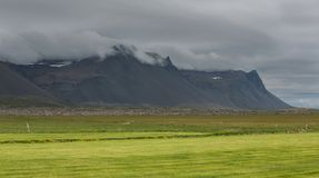 Mountains and clouds in Iceland Stock Photos