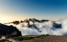 Mountains in clouds landscape Stock Images