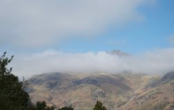 Mountains in clouds Langdale Pikes, Lake District UK royalty free stock photo