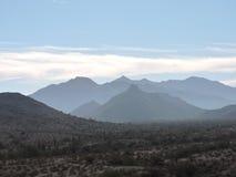 Mountains clouds Stock Photos