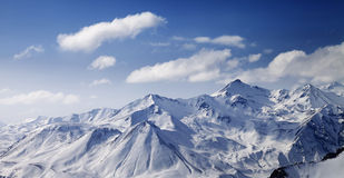 Mountains in clouds at nice winter day Royalty Free Stock Photo