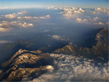 Mountains and clouds from plan. A view of mountains and clouds during sunset from the airplane going from Italy to France Stock Images