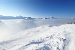 Mountains in clouds with snow in winter Stock Photos