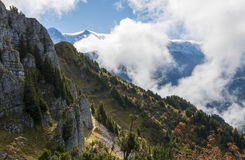 Mountains in Clouds and Sunlight Switserland Alps. Alps and Autumn Mountains in sunlight in  Switserland with clouds and blue sky Stock Photos