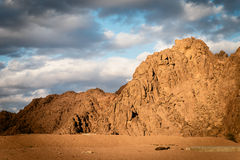 Mountains and clouds at sunset. Arabian desert, Egypt. Royalty Free Stock Photos