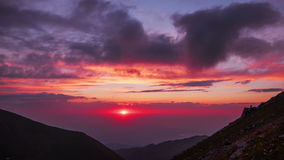Mountains clouds sunset time lapse 4k stock footage