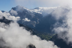 Mountains in Clouds Switserland Alps. Alps and Mountains in Switserland with clouds and blue sky Royalty Free Stock Photography