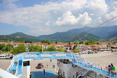 Mountains, cloudy sky, the ferry to the island Thassos Royalty Free Stock Images