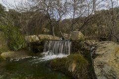 Water streams, rocks, trees and beatiful sky.Hoyo de Manzanares, Madrid, Spain. Through the mountains of the community of Madrid it is common to find currents royalty free stock photos