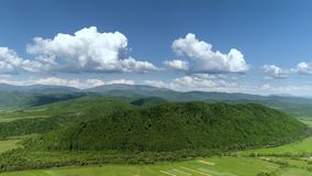 Mountains covered with green forest and river. Carpathians. View from above. stock video