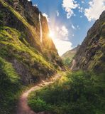 Mountains Covered Green Grass, High Waterfall At Sunset Stock Images