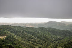 Mountains covered with heavy fog and storm clouds. Royalty Free Stock Image