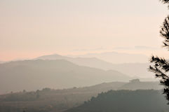 Mountains covered with heavy fog at sunset. Royalty Free Stock Photos