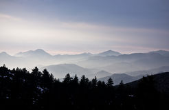 Mountains covered by mist Stock Photos