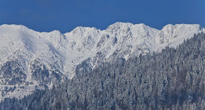 Mountains covered in snow and blue sky Royalty Free Stock Images