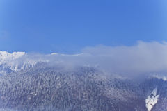 Mountains covered in snow and blue sky Royalty Free Stock Photos
