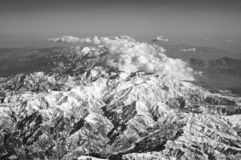 Mountains covered with snow and clouds, aerial view. Earth planet surface. Travelling around world. Environment. Protection and ecology. I take my earth with a royalty free stock images