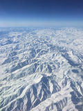 Mountains covered with snow. Everest mountain and surroundings covered with snow. Image captured from plane Stock Photo
