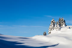 Mountains covered with snow and surrounded by clouds Royalty Free Stock Image
