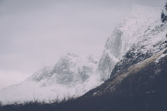 Mountains Covered With White Snow during a Gloomy Day Royalty Free Stock Photography