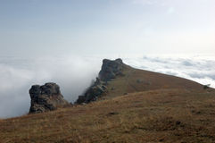 Mountains of Crimea. Top of Dimerdzhi in clouds. Southern coast of Crimea Stock Image