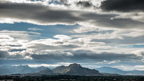 Mountains and dark clouds Stock Image