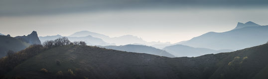 Mountains at dawn in the mist. Stock Images