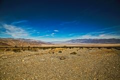 Mountains Death Valley salt flats. Brown mountain surrounding the dry lake bed salt flats in Death Valley California stock photo