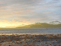 Mountains in the distance. With the midnight sun shining Stock Photography