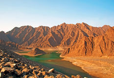 Mountains in the Dubai Desert. Hatta Dam Lake with mountains in the background Stock Photo