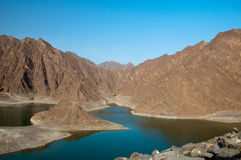 Mountains in the Dubai Desert. Hatta Dam Lake with mountains in the background stock photography